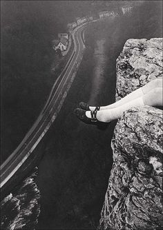 Paul Hill, Legs Over High Tor, Matlock, Derbyshire, 1975. Surprising perspective.