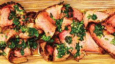 This Grilled Flank Steak with Chimichurri Sauce is the perfect way to feed a crowd - not only is this cut lean and flavorful, but it`s also inexpensive.  Marinated in an oil, vinegar and mustard mixture, the flank steak is grilled to melt-in-your-mouth tenderness and then topped with a Latin chimichurri sauce, the blend of fresh herbs, lemon juice, garlic and olive oil.