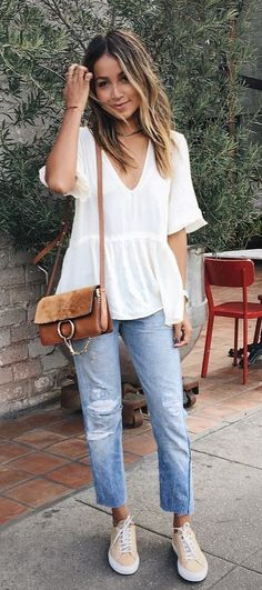 summer outfits  White V-neck Blouse + Ripped Jeans + Beige Sneakers