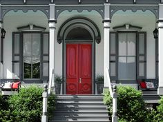 The restored double front doors of this 1870s Italianate pack a welcome punch of color with a custom shade of red. Pale blue, true to the period, coats the ceiling. Similar to shown: Moroccan Red (door) and Glacier Blue (ceiling), about $60 per gallon; Benjamin Moore | Photo: Gridley + Graves
