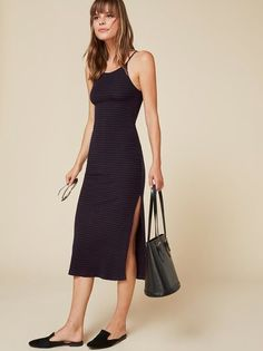 Give your curves a hug. This is a tight fitting, sleeveless dress that hits below the knee.
