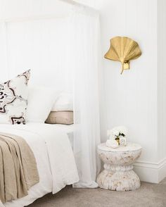 It's all in the details baby  If you could have one thing from Bon's master... what would it be? #getthelook  Gold Sconces from @lightingcollective | Bed from @theincystore | Throw and Linen from @ilovelinen |Orchid from @freedom_australia | Tiles from @nationaltilesau | Side Table @zanui | Cushions by @gracegarrettdesign #bonniesdreamhome #moderncoastalbarn