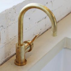 Bert & May deck mounted kitchen tap in solid brushed brass made in London