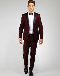 a burgundy tux would be amazing - but then i'd say to avoid being too matchy matchy i'd just have the lip color and the bouquet would be mainly oranges and mauves but with burgundy moments. definitely wouldn't have the bridesmaids in mauve then... i need a real color scheme