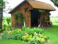 This custom garden shed doubles as a gardener's workshop, with enough room to house of a gardeners most important tools. Greenhouse Shed, Garden Tool Shed, Backyard Sheds, Fire Pit Backyard, Backyard Patio, Garden Buildings, Garden Structures, Outdoor Structures, Porches