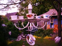 Tea Cup Chandelier ( cute idea for an Alice in Wonderland party decor!)