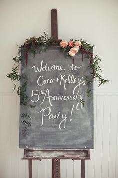 Cute chalkboard welcome sign with florals. I love how light the actual chalkboard is