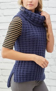 Free Knitting Pattern for 4 Row Repeat Waffle Stitch Vest - Pullover vest in a 4 row repeat stitch pattern with cowl neck and high-low hemline. Rated easy by Red Heart though it does require picking up stitches to knit the collar. Sizes Small to 3XL. Designed by Jodi Lewanda for Red Heart. Quick knit in bulky yarn.