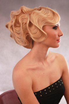.front sections extra large finger waved then wrapped around large low bun in the back.