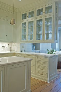 Glass cabinets between the breakfast nook and the office would be another way to go, but only if there is some way to tie the looks of the two rooms together.