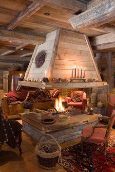 Tjusigt! Men jag hade nog velat att träväggarna, tak, golv och bjälkar var lite mer mörkare, i mahogny... Och en mjukare soffa.