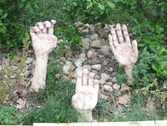 yard sculpture - could maybe do this with rubber gloves and hypertufa?