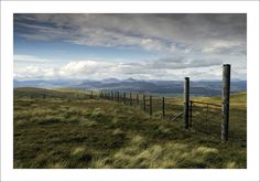 https://flic.kr/p/z1aTR4 | HIGH WIRE | Westwards from below the summit of Ben Cleuch, the highest of the Ochil Hills. Stuc a'Chroin and Ben Vorlich, both Munros, are in the distance above a wind farm. On Monday I walked over Ben Ever, Ben Cleuch, Andrew Gannel Hill, and Blairdenon Hill. 20km with 1230m (4,000+ft) of climbing over the 4 westernmost high summits in the Ochils.  Thanks for looking and for any comments / faves.