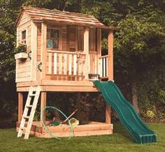 "Backyard playhouse-could be a perfect coop! A covered dustbath ""spa"" underneath, and a SLIDE! Wonder if the chickens would slide down? LOL"