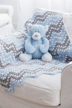 This blue, gray and white crocheted afghan definitely says baby boy!