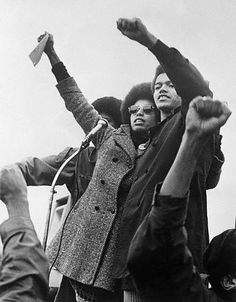 Angela Davis wearing a long pea coat likely made of wool or tweed like material. Angela Davis, Grand Jury, Karl Marx, Women In History, Black History, African American Leaders, Black Panther Party, Vintage Black Glamour, Power To The People