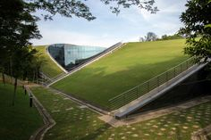 Nanyang Technology University - School of Art, Design and Media building in Singapore. Cladding Materials, Fibreglass Roof, Living Roofs, Concrete Building, Roof Architecture, Sky Garden, Roof Light, World Photo, Roof Design
