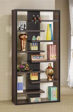 This is a staggered dark brown modern cube-style vertical bookshelf that creates a pleasing display.  Because the shelves are staggered, there's quite a bit of empty space.