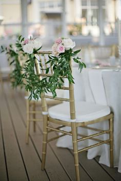 Wedding Chair Swag Decorations - Dress your wedding chairs up with a few deep green leaves and roses in pretty colours. #Wedding #Chair #Swag #Decoration