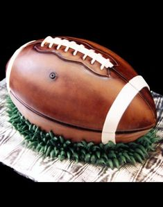 I do not totally understand football but super cool cake! love the effects on the football!
