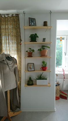 hanging garden, flower shelf made with tar treated rope. Smells divine ❤️