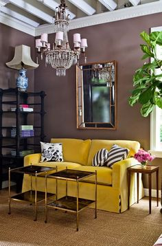 Loving the couch with the tiny bit of black and white stripes peeking out at the bottom. Not loving the lamp or chandelier.