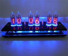 Six-Digit Nixie Tube Clock.  The only problem with this would be, we'd have to get two, or else we'd always be stealing it from each others' offices.