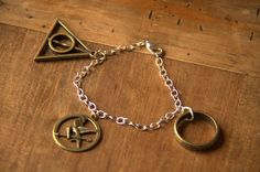 Hunger Games Harry Potter Lord of the Rings by LittleTrinkets8D, €18.00 Oh my goodness! This bracelet has my life on it!! <3 Harry Potter, Hunger Games, Lord of the Rings <3