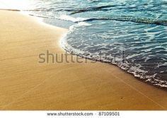 Shiny Tropic Sea Wave On Golden Beach Sand In Sunset Light Stock ...