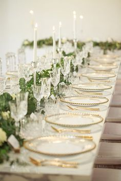 Greenery wedding reception table runner with gold plateware and crystal details | Jason Soon Photography