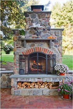 Good idea with place for wood. elements Portfolio Driveways Fireplaces Outdoor Kitchens Landscape Lighting Plantings Ponds Structures DeMichele Inc. Landscape Design and Installation, Media, Pennsylvania.