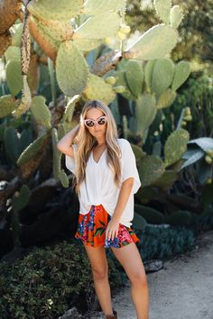 White knotted top + pink brunch sunglasses + printed Carlos shorts
