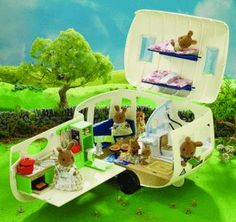 $75.84 The Sylvanian Caravan has everything needed for staying away from home.  Open up the roof and side to reveal a very well equipped kitchen area with sink, stove, drawers, cupboards and even a fold-out ironing board. There's a seating area which converts into a double bed and coffee table.There are 2 further fold-out bunks on board and towards the rear there's a shower room with fold-out loo and a wash-hand basin. Includes over 30 accessories.  Ages 4+ years