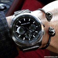his Michael Kors Chronograph Watch nicely paired with our Gunmetal Black Facetted Twin Skull Bangle.