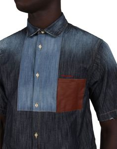SQUARED MIX LEATHER POCKET SHIRT: Graphic shapes in a leather pocket and different shaded panels of denim make this a stylish summertime shirt. Team it with tailored pants and leather lace-ups for an offbeat but cool warm-weather outfit.
