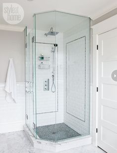 Shower design The glassed-in shower, walls of white bevelled subway tile with an accent of moonstone blue limestone mosaic, which was also used on the shower floor. Clean-lined fixtures continue the linear motif to this side of the room. New Bathroom Ideas, Bathroom Inspiration, Small Bathroom, Bathroom Marble, Marble Wall, Wall Tile, White Bathrooms, Marble Floor, Upstairs Bathrooms