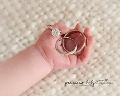 beautiful photo of newborn's hand holding mom and dad's rings. Diamond wedding bands parents close up Precious Baby Photograph by Angela Forker creative photography unique Fort Wayne New Haven Indiana