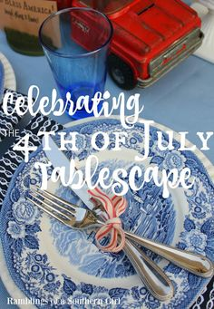 Celebrating the 4th of July Tablescape. French blue toile patterned dishes with silver flatware fastened with ribbon resembling ticking playing against a slight vintage Americana decor style.