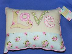 Shabby chic cushion various prices from £.0.90 on ebay, I love the colours, would look so pretty on my bed!