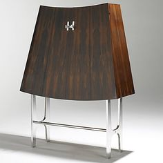 RENE-JEAN CAILLETTE; CHARRON; Bookmatched rosewood and nickel-plated steel cabinet;  57 1/2'' x 44'' x 16 1/4''