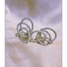 Margherita Burgener Olympia earrings Diamond and 18k white gold or in titanium.