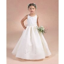 Sweetie Pie Collection style 627 is a Communion Dress with floral motifs. It is Peau satin, tissue chiffon, embroidered floral motifs, attached cummerbund with tails that tie back.