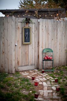 """I like how this is a privacy fence with a door matching...chalboard could read """"welcome"""" or """"The Hardins"""""""