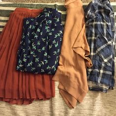2 skirts 2 collard shirts  Hello beautiful humans of Poshmark, these clothing items have not been worn for a very long time.. Which means that they are fresh and in good condition. Pretty please, with an organic cherry on top -do not ask for me to post a picture that consists of me wearing these items. I'm not going to. And I'll just ignore the comment(s). Forever 21 Tops Blouses