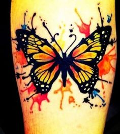 Orange and black watercolor butterfly tattoo