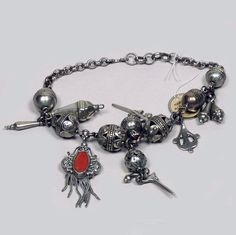 Algeria   Chain with a number of pendants from the Kabyle people; silver and coral. ca. 1900.   ©Pitt River Museum.