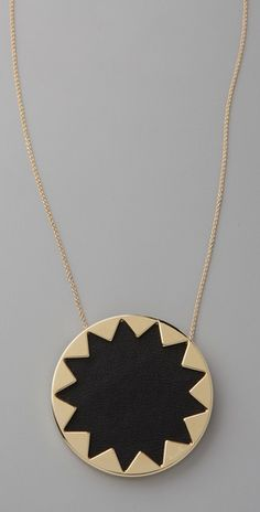 This Sunburst Pendant Necklace reflects my sunny outlook on life, in a wonderfully mod/minimal way.
