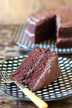 A close up of a big slice of the Best Vegan Chocolate Cake. This vegan cake is quick and easy to make and tastes delicious. It's light, fluffy and you don't need any unusual ingredients for the recipe.