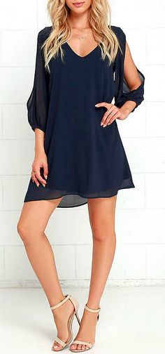Lulus Exclusive! When it's time to shift your gears into glamor mode, the Shifting Dears Navy Blue Long Sleeve Dress is our most dearly beloved dress! Navy blue chiffon forms a roomy shift silhouette with a deep, scoop neckline and a flared shape that flows into an asymmetrical, concave hemline. Long, sheer sleeves have on-trend, cold shoulder cutouts that open all the way to the cuffs. #lovelulus
