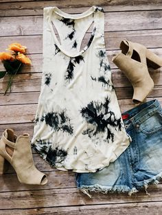 Tie dye print, waist length sleeveless top in a relaxed style with a scoop neck, a racerback and a scalloped hem. 95%Rayon 5%Spandex                                                                                                                                                      More